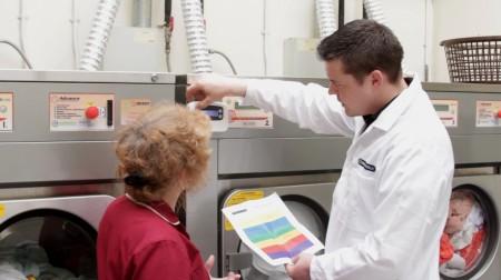 Expert showing dosing system on washing machine